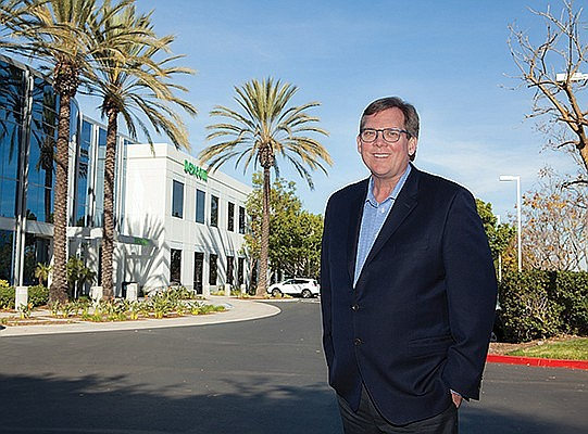 Dexcom CEO Kevin Sayer stands in front of the company's headquarters. The diabetes company has seen explosive growth in the last year. Photo courtesy of Dexcom Inc.