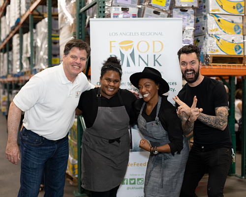 """Michael Flood, President and CEO of the Los Angeles Regional Food Bank (left), with Chefs from the summer 2019 """"Howlin' with Harris"""" event, presented by Billy Harris."""