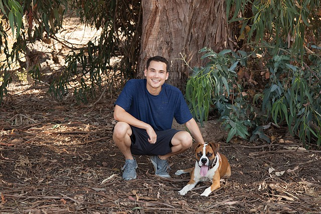 Culture Fit: Pawstruck Chief Executive Kyle Goguen with his boxer, Tyson, the company's chief canine officer.