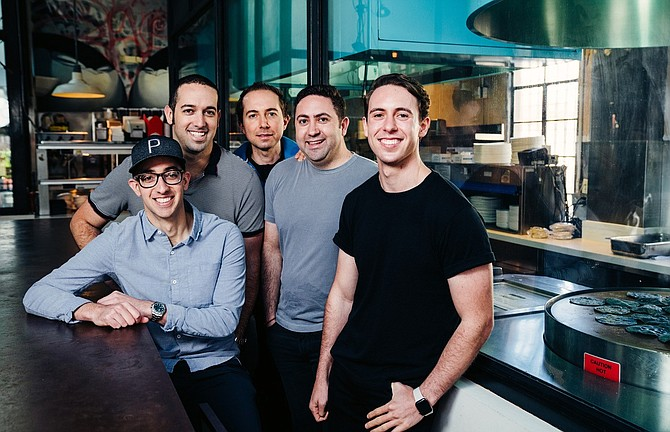 Puesto Mexican Artisan Kitchen & Bar was founded in 2012 by brothers Alan, Alex, and Eric Adler, and cousins Isidoro and Moy Lombrozo, all pictured here. Photo courtesy of Puesto  Mexican Artisan Kitchen & Bar.