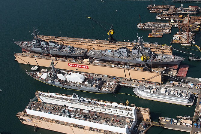 U.S. Navy ships undergoing maintenance at BAE Systems. Note two ships in dry dock. Photo courtesy of BAE Systems San Diego Ship Repair.