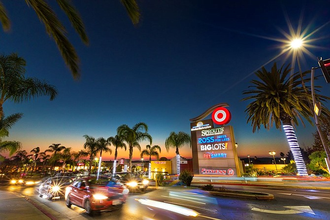 Improvements to Mission Marketplace shopping center included the November opening of a movie theater renovated by Regal Cinemas. Photo courtesy of JLL.