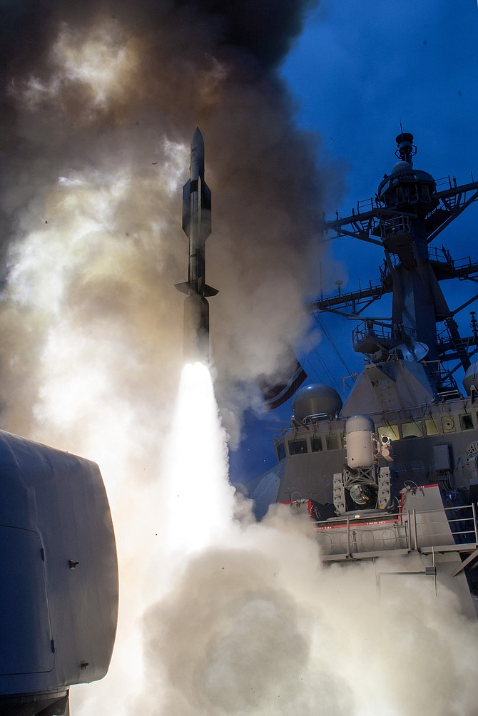 The USS John Paul Jones launches a Standard Missile-6 in 2014. Raytheon received a U.S. Navy contract to perform missile support in San Diego. Photo courtesy of U.S. Navy.