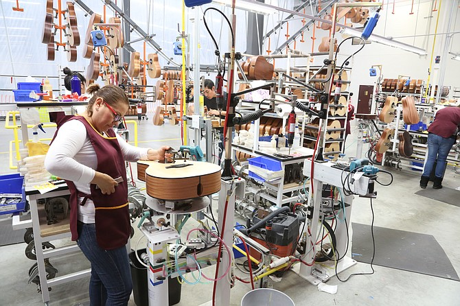 A Taylor Guitars employee works in the Tecate plant. The competition for labor is high. Photo courtesy of Taylor Guitars.