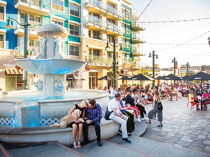 A fountain at the east end of Piazza della Famiglia adds to Little Italy's European feel. Photo courtesy of H.G. Fenton Co.