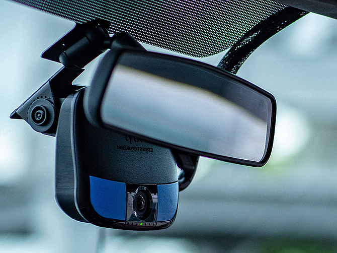 The Lytx camera, placed in the center of the windshield, monitors conditions on the road. Photo courtesy of Lytx Inc.
