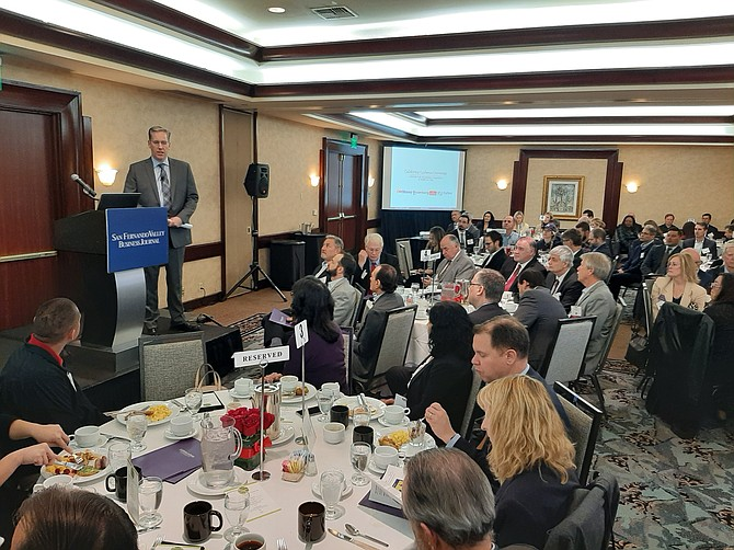 Economist Matthew Fienup presents to the crowd at the Business Journal's economic forecast breakfast.