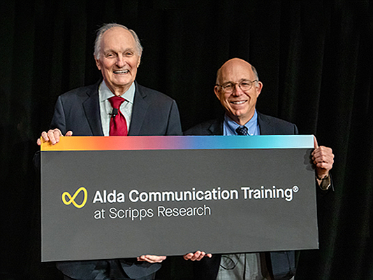 Photo courtesy of Scripps Research. Actor Alan Alda (left) and Scripps Research CEO Peter Schultz