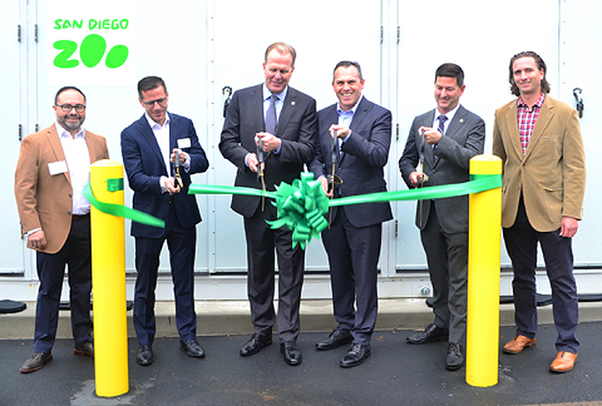 Photo courtesy of the Business Wire. San Diego Zoo and EDF Renewables cut the ribbon on the Zoo's battery storage. (from left) Alex Martinez,, Raphael Declercq, San Diego Mayor Kevin Faulconer, Paul Baribault, Chris Ward, Michael Robinson.