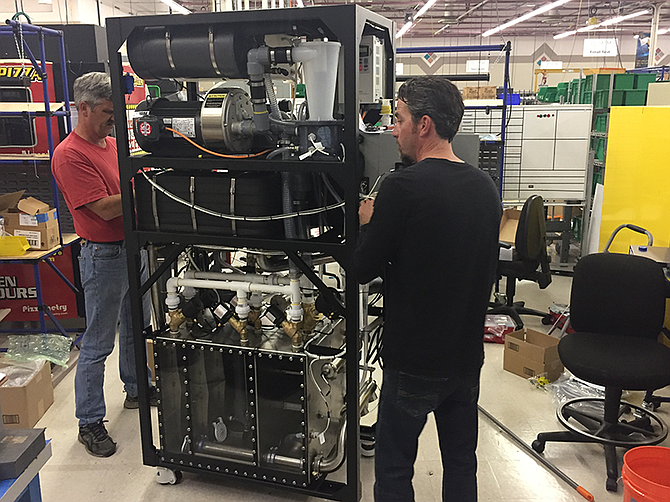 Photo courtesy of Chilldyne. Ryan Butrym, of Chilldyne, at D&K engineering with Kevin Warneke, of D&K, assemble a cooling distribution unit (CDU).