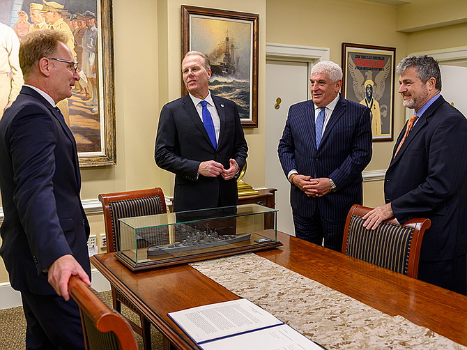 Photo courtesy of U.S. Navy. Acting Navy Secretary Thomas Modly with Mayor Kevin Faulconer and SANDAG Executive Director Hasan Ikhrata prior to signing their agreement Jan. 23 at the Pentagon. At right is Lucian Neimeyer, the Navy's assistant secretary for energy, installations and environment.