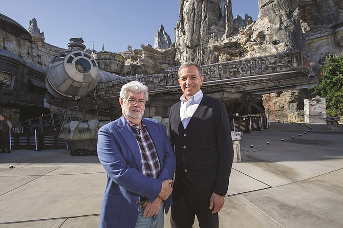 George Lucas and former Disney CEO Bob Iger at Star Wars: Galaxy's Edge in Disneyland.