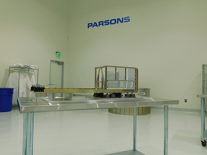 A container holding the small satellite set to launch into space on March 19, 2020, in Parsons' new facility near Torrance.