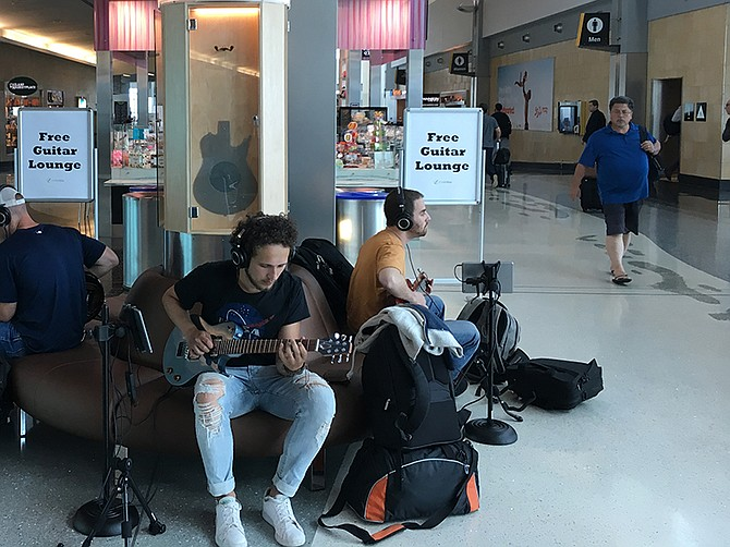 Photo courtesy of Ciari Guitars.  The Music Oasis kiosk gives guitar players a free place to play and try out a Ciari guitar at the airport.