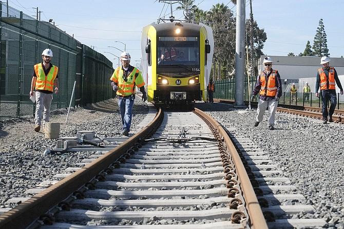 Crews conduct a test on the Crenshaw-LAX light rail line.