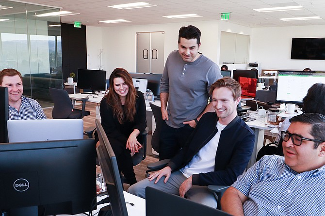 Welcome's founder, Amir Hemmat (center), with Welcome Technologies' engineering design team.
