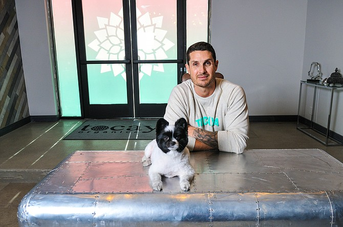 Tosh Berman, CEO and founder, Madera Group, with his dog, Panda.