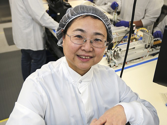 Photo by Jamie Scott Lytle. Hong Cai, the CEO of Mesa Biotech, in the company's lab. Mesa Biotech developed a COVID-19 test that tells if someone has the virus in 30 minutes
