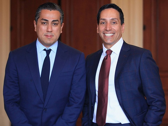 Behdad Eghbali and José E. Feliciano of Clearlake Capital Group.