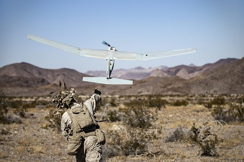 Soldier launches AeroVironment's Puma 3 drone.
