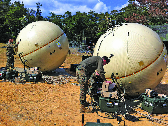 File photo courtesy of Cubic Corp. U.S. Marine tends to GATR inflatable antenna.