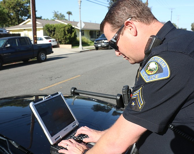 Police officer using CalAmp tracking technology
