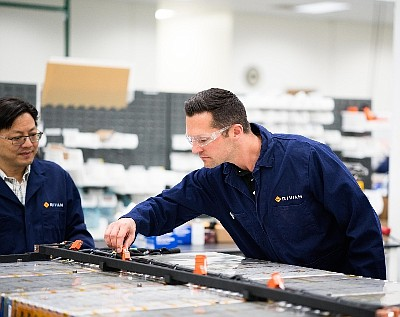 Workers in Rivian's Irvine battery facility.