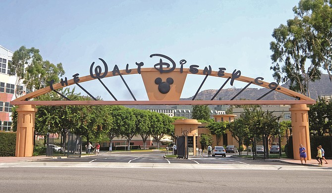 Walt Disney Co. said earnings were hurt by theme park closures and the loss of live sports programming.