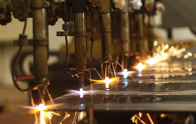 CNC LPG gas cutting close-up with water cooling
