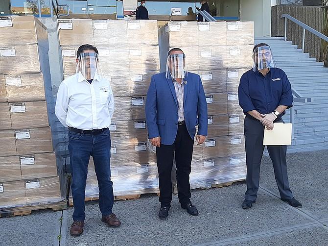 Photo courtesy of Biotix. Biotix executive leadership team standing next to 5,000 masks the company donated to the city of Tijuana.