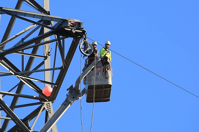 Edison workers perform maintenance.