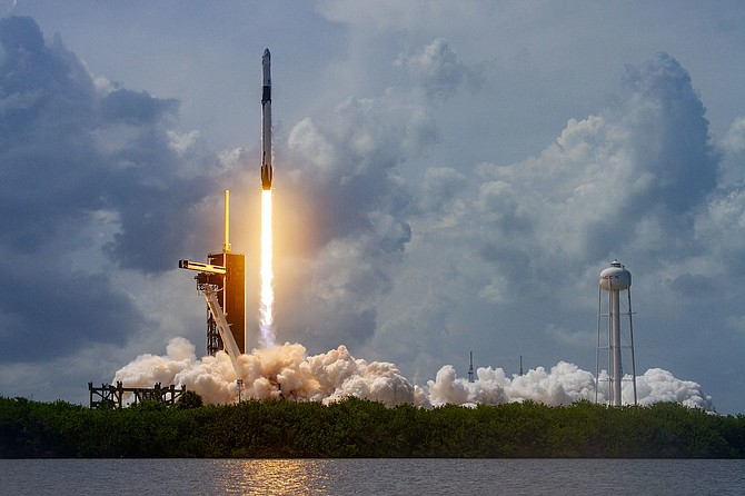 The SpaceX Falcon 9 rocket with the company's Crew Dragon spacecraft onboard is seen taking off on Thursday, May 30. It docked with the International Space Station on May 31.