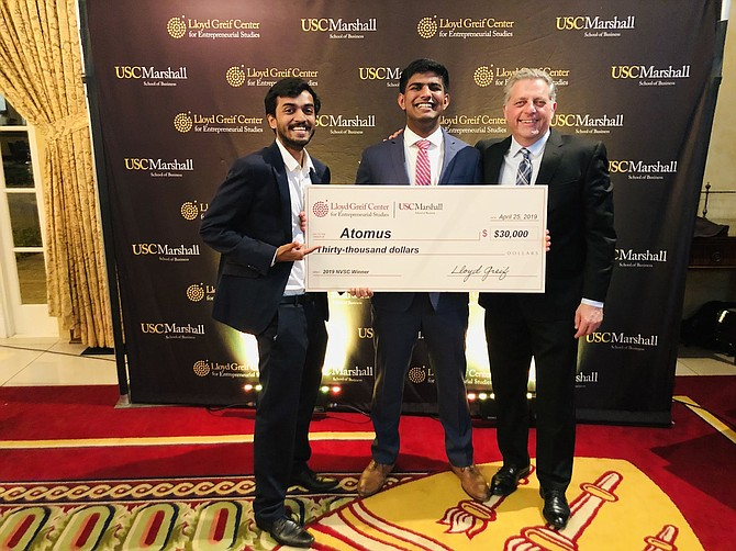 Atomus co-founders Kaushal Saraf (left) and Joel Joseph (center) with Albert Napoli (right), USC lecturer of clinical entrepreneurship with a check from the New Venture Seed Competition, a business competition held at USC.