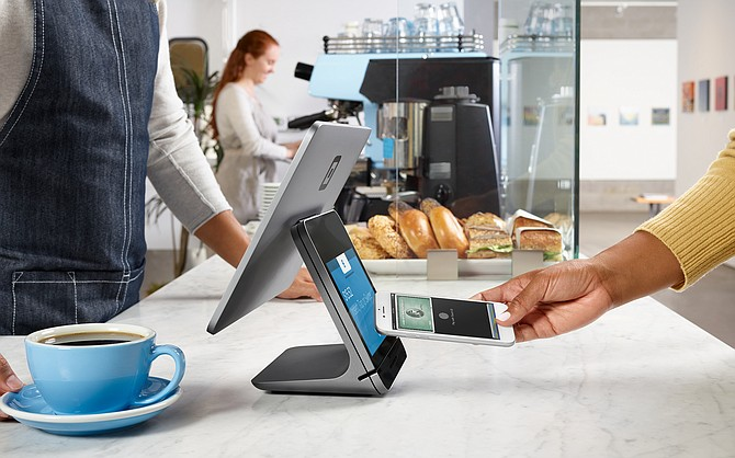 A customer uses Square's contactless payment system.
