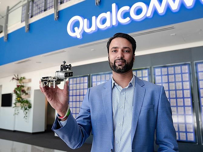 Photo courtesy of Qualcomm. Dev Singh of Qualcomm Technologies, holds up Robotics 5BR platform.