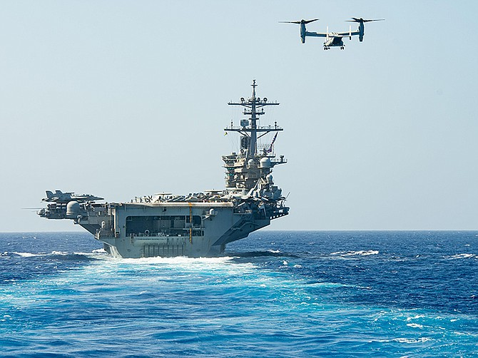 Photo courtesy of U.S. Navy. An MV-22 Osprey tiltrotor aircraft prepares to land on the USS Theodore Roosevelt in the Pacific Ocean in February. The Navy plans to replace its Greyhound aircraft with Ospreys.