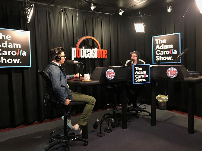 "PodcastOne is the home of the popular ""Adam Carolla Show."""