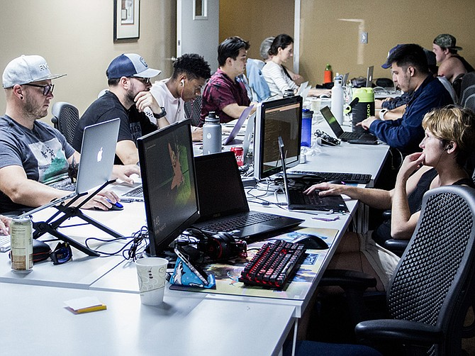 Photo courtesy of San Diego Code School. Students at SD Code School learning full-stack development.