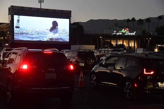 """Moviegoers attend the Tribeca Drive-In screening of """"Jaws"""" at the Rose Bowl."""
