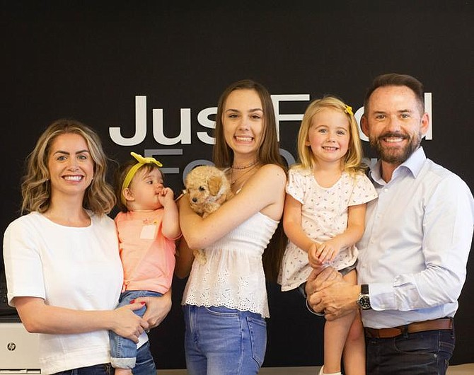CEO Nielsen (right) with wife Emily and daughters, Isabella, Emma, Lola, and Penelope, and rescue puppy Squash