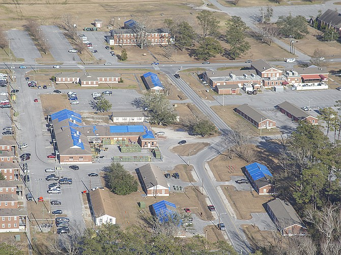 Photo courtesy of U.S. Marine Corps. Blue tarps cover roofs at Marine Corps Base Camp Lejeune following Hurricane Florence. A local joint venture is going to North Carolina to be part of the rebuilding effort.