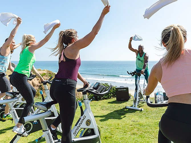 Photo courtesy of Fit City Adventures. Earlier this year, Fit City Adventures hosted a spin class above Law Street beach.