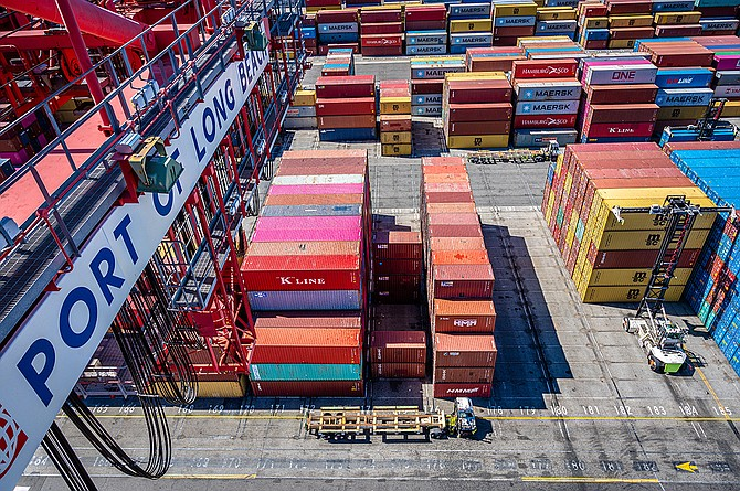 Online spending and extra vessel visits in July drove up cargo volumes at the Long Beach and L.A. ports.