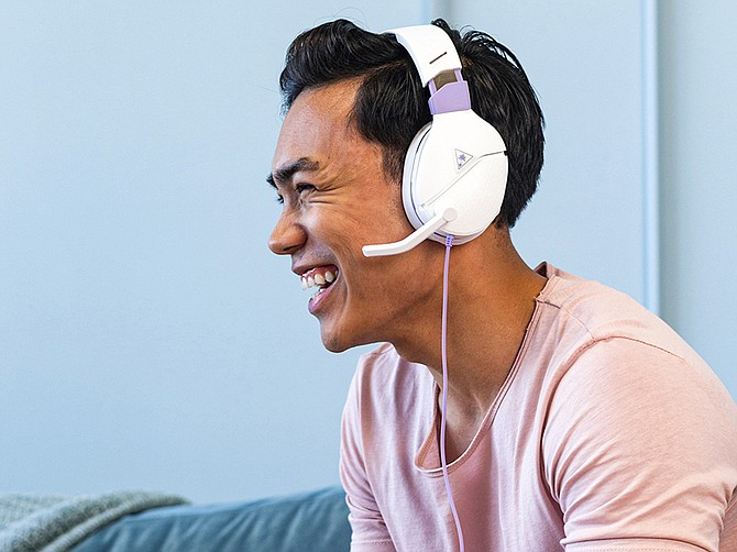 Photo courtesy of Turtle Beach Corp. A model wears Turtle Beach's Recon Spark headset. Gaming and gaming peripherals are selling well under pandemic conditions.