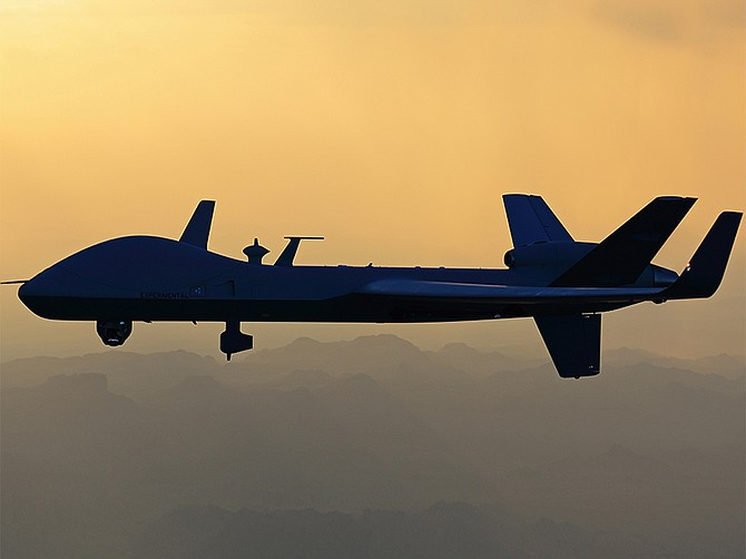 Photo courtesy of General Atomics Aeronautical Systems Inc. An MQ-9B SkyGuardian aircraft flies through the haze. The government of Belgium is buying four such aircraft from General Atomics Aeronautical Systems Inc.