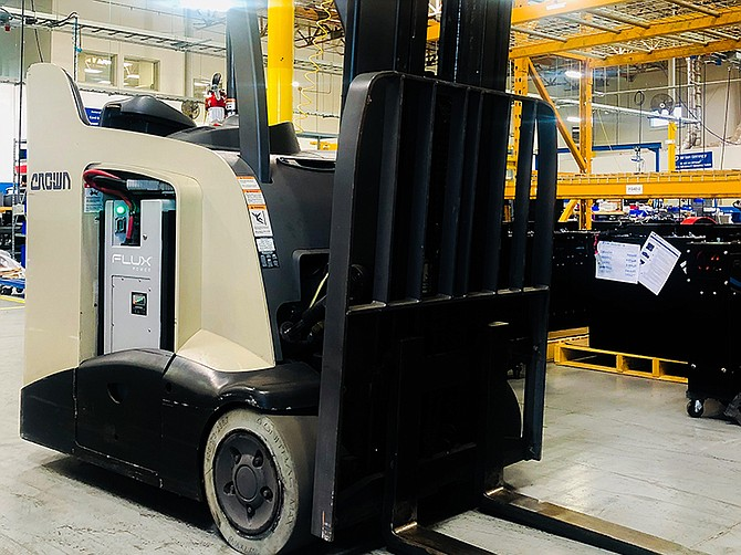 Photo courtesy of Flux Power. A Crown forklift carries a Flux Power lithium ion battery. With $11.4 million in hand from a follow-on stock offering, Flux Power plans to continue its growth, its CEO said.