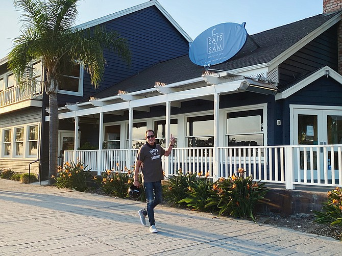Eats by Sam, located at Seaport Village, will open as a multi-concept ghost kitchen later in the fall. In the foreground is Sam Zien, better known to his video audience as Sam the Cooking Guy.