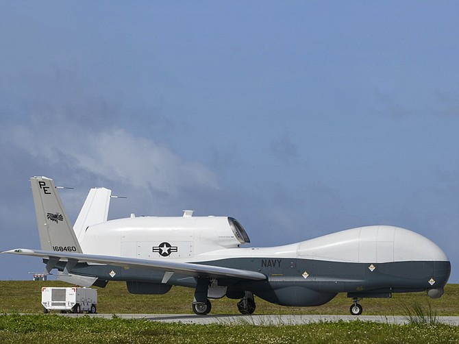 Photo courtesy of U.S. Navy. A U.S. Navy Triton unmanned aircraft taxis at Andersen Air Force Base in Guam in an image from April. Builder Northrop Grumman says it may have to temporarily close the Triton production line if the 2021 Pentagon budget proposal is not amended.