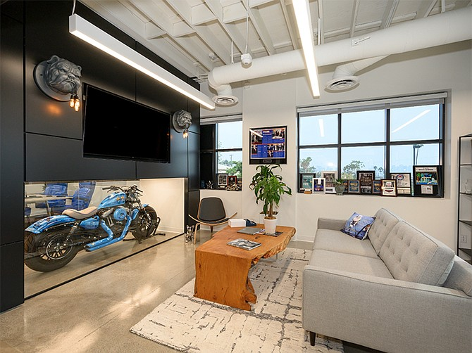 Photo courtesy of Batta Fulkerson Law Group. The new offices of Batta Fulkerson Law Group have a glass-enclosed motorcycle in one wall.