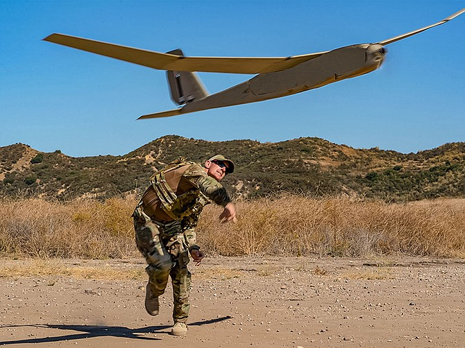 Photo courtesy of AeroVironment. A soldier launches a Puma aircraft built by Aerovironment. Carlsbad-based Viasat has teamed up with Aerovironment to work on secure radio communications technology for small unmanned aircraft like the Puma.